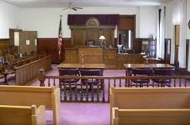 """The courtroom is the setting of one of the most pivotal moments during the novel. It is where Absalom is accused guilty of murder and sentenced to death. His death affected many others within the book. """"The judge sits, and then his two assessors, and then the people; and the three accused are brought from the place under the Court."""""""