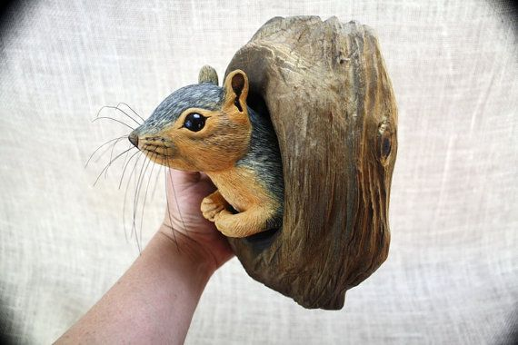 Fox Squirrel Wood Carving Hand Carved by Mike Berlin Life sized Fox Squirrel poking his head from a knothole hole carved from Basswood. Wall hanging