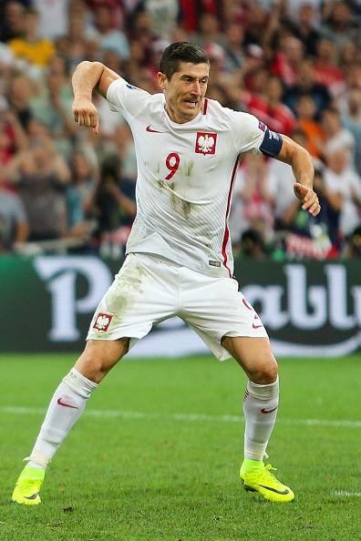 #EURO2016 Poland's forward Robert Lewandowski celebrates after scoring a penalty during the Euro 2016 quarterfinal football match between Poland and Portugal...