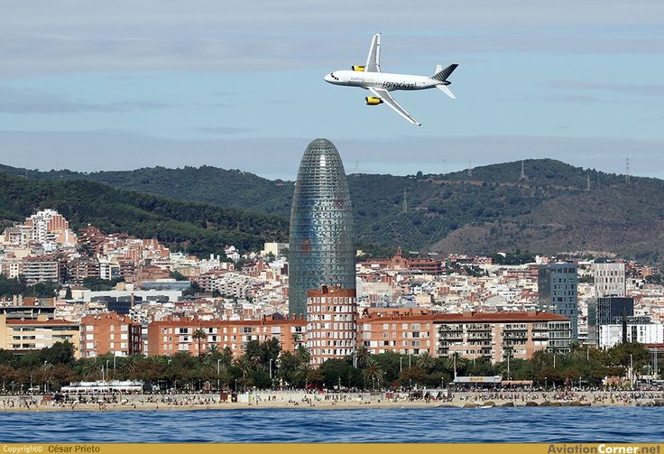 Vueling Airbus A320 flying in over Barcelona. We expected Iberian Airlines, but found Vueling making the run from Granada to Barcelona. Tightest airline seat I've ever sat in.