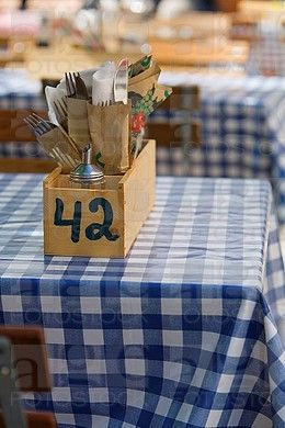 Cutlery in wooden box on typical German beer garden table, Munich, Germany.