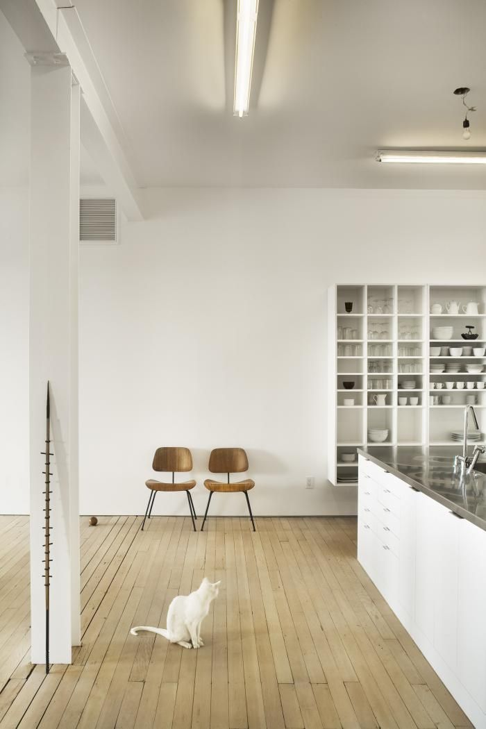 White Loft by Qb3 in Philadelphia, 'smart' storage bookshelves/display cases/room dividers, bleached maple floors, Eames chairs, Remodelista
