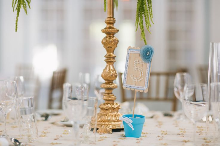 Candelabra stand and table number  http://www.fusion-events.ca/