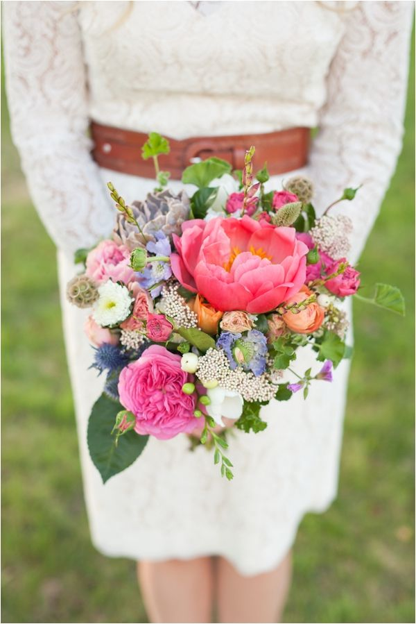 We love the varied textures and colors of this gorgeous bridal bouquet.