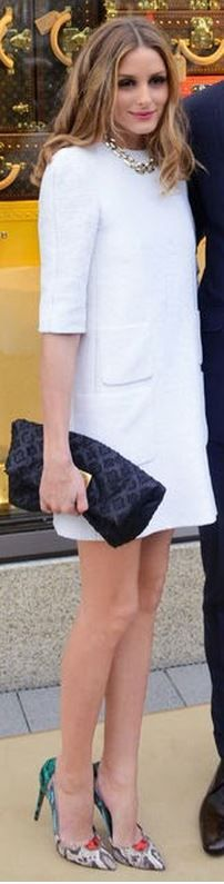 Who made  Olivia Palermos snake print pumps, black handbag, and white pocket dress?