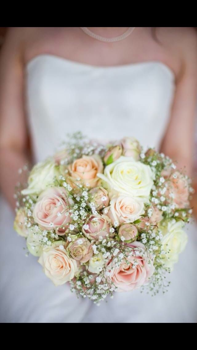 Example textured bouquet using a variety of roses, spray roses and gypsophila