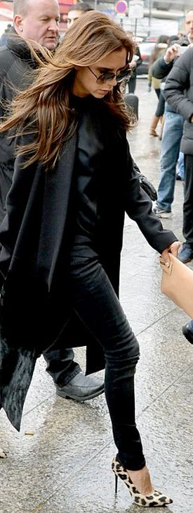 Who made  Victoria Beckham's black coat, tan clutch handbag, sunglasses, and skinny jeans that she wore in London?