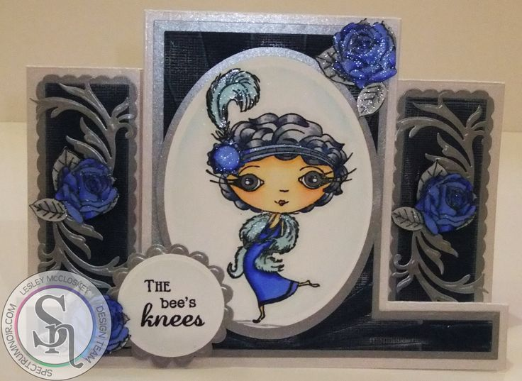 Designed by Lesley McCloskey. Verity Rose Starlet stamp coloured with Spectrum Noir pens and Sparkle pens. Hair - TB9, BGR1, BGR3. Skin - FS2, FS3, TN2. Lips - CR8. Clothes - TB3, TB5, TB6, moonstone, crystal clear, BGR1. Ground - BGR1, BGR3. Sky - IG1. Roses from Starlet accessories (Verity Rose range from Crafter's Companion) coloured with Spectrum Noir pens and Sparkle pens - TB3, TB5, TB6, BGR1, BGR3 and crystal clear. #spectrumnoir #crafterscompanion #handmade #swinging50s #50's