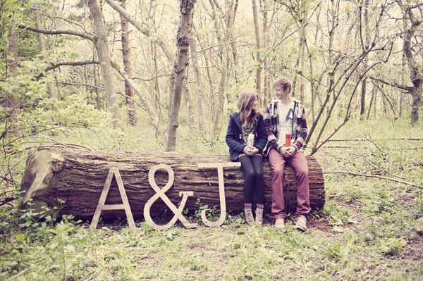 ruby-roux photography.  engagement shoot.  love. hug. embrace. couples. flask  woodland. woods.  log.  big letters. props.  www.ruby-roux.com