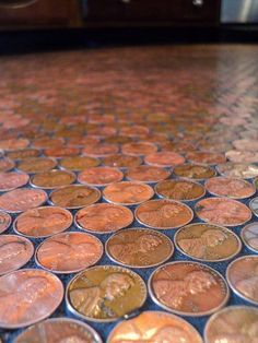"""I used Weldbond Glue to adhere each penny, individually, to my floor. ALL wax was removed from the floor before I started. To be just a little crazy, I made each penny heads up & facing the same direction. Here and there, I would throw in a dime.... and when I found a cool penny (like a wheat penny), I put them tails up. It gave everyone something to look for. As I finished a section, I grouted them. I used black, sanded grout. Kept dirt from finding it's way into the cracks & looks…"