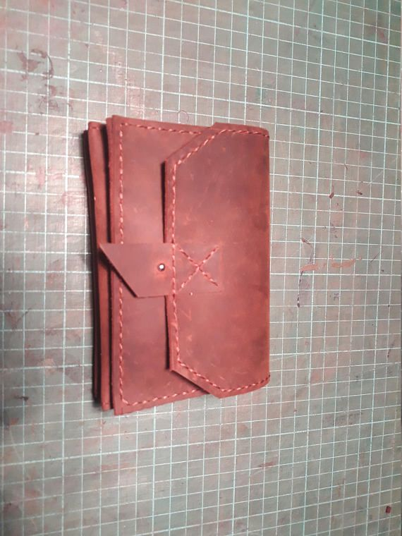 Hand stitched natural leather wallet.