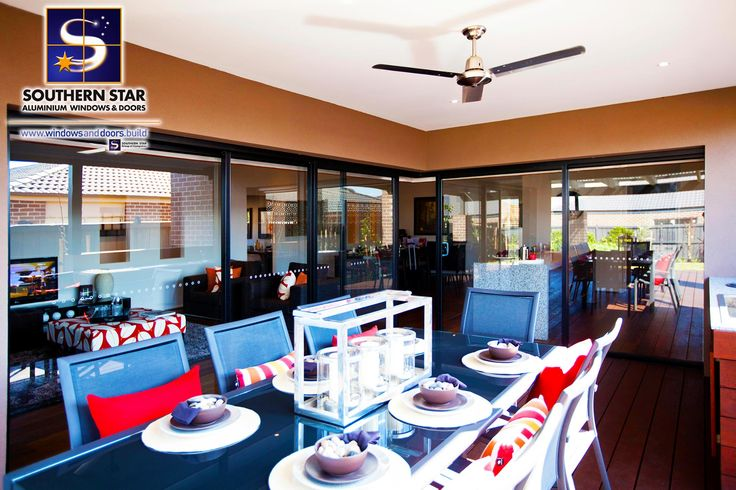 Alfresco dining with an abundance of natural light through Southern Star aluminium sliding doors and windows all around.