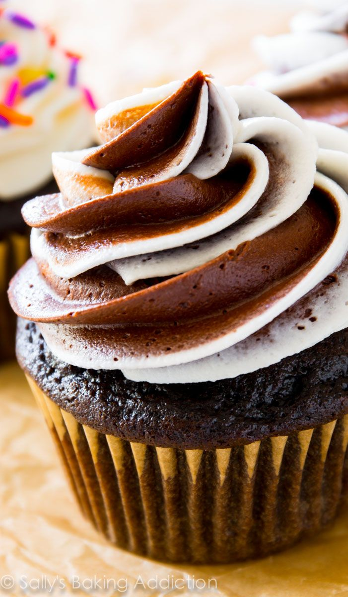 The one and only homemade chocolate cupcake recipe you need! Topped with fluffy, rich vanilla chocolate swirl frosting. @Sally McWilliam [Sally's Baking Addiction]