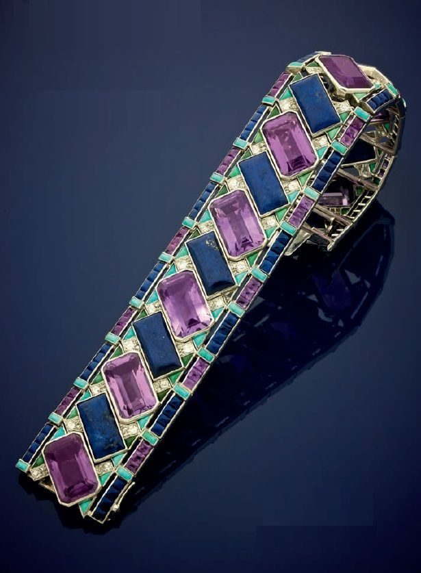 Attributed to Cartier - An elegant and rare Art Deco platinum, diamond and gem set bracelet, French, about 1930. The bracelet contains emeralds, amethysts, lapis lazuli, diamonds and turquoises. Probably made by Cartier for export, with a trace of maker's mark. #Cartier #ArtDeco