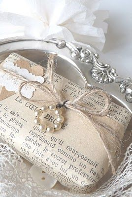 Old book pages make unusual gift wrapping. #giftwrap