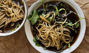 Miso soup, noodles and cabbage in three bowls on crinkled paper