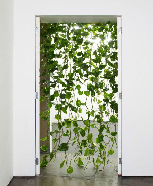 A green and contemporary spin on the beaded curtain door