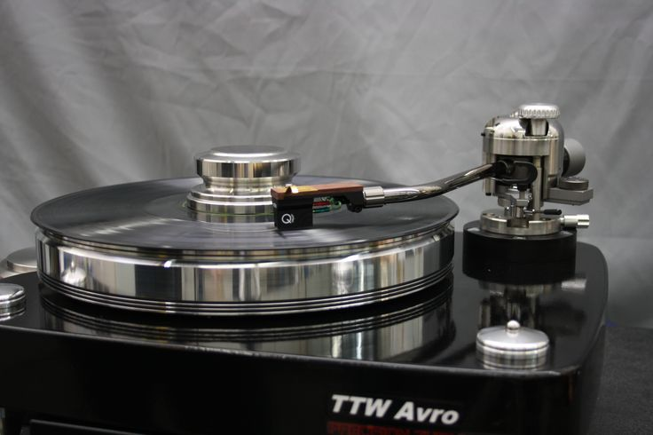 The NEW Avro Tri-Belt turntable unbeatable performance, carbide bearing system, DC servo drive and digital controller, on Board tone arm is the Avro 9 inch tone arm.