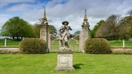 The piping Shepherd Boy and dog statue in the Green Court looking over to the parkland