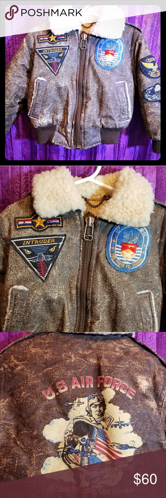 "Vintage Childs Bomber Jacket Great condition vijntage kids bomber jacket. Size 4. Has patches on front and on sleeves and has print on back that says ""U.S. Air Force - 40 Years Protecting Our Freedom"" TopStar Jackets & Coats Puffers"