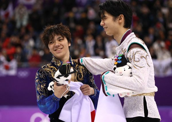 Silver medal winner Shoma Uno of Japan and gold medal winner Yuzuru Hanyu of Japan celebrate during the victory ceremony for the Men's Single Free Program on day eight of the PyeongChang 2018 Winter Olympic Games  at Gangneung Ice Arena on February 17, 2018 in Gangneung, South Korea.