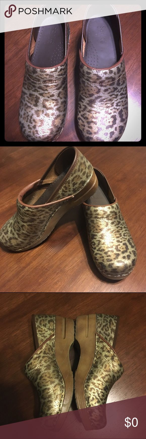 Sanitas women's clogs Beautiful shimmery brown leopard Sanitas clogs. Look brand new except for the bottoms. Sanitas Shoes Mules & Clogs