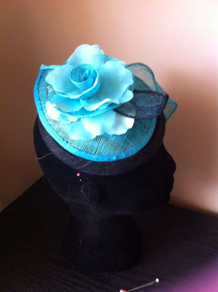 Black and real base with teal flower.