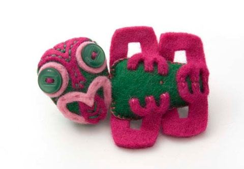 felt tiki brooch  Awesome handmade felt tiki brooch by the very clever Ms Arana Horncy. A treasure.