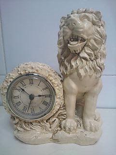 cositasdemiabuelo: Reloj de sobremesa. Figura de León
