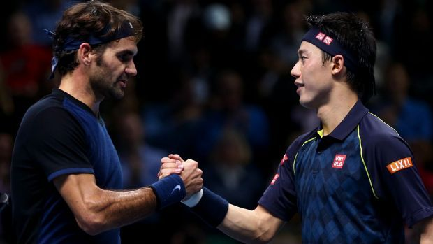 Roger Federer shakes hands with Kei Nishikori after his victory in their match at Barclays ATP World Tour Finals in 2015 ...