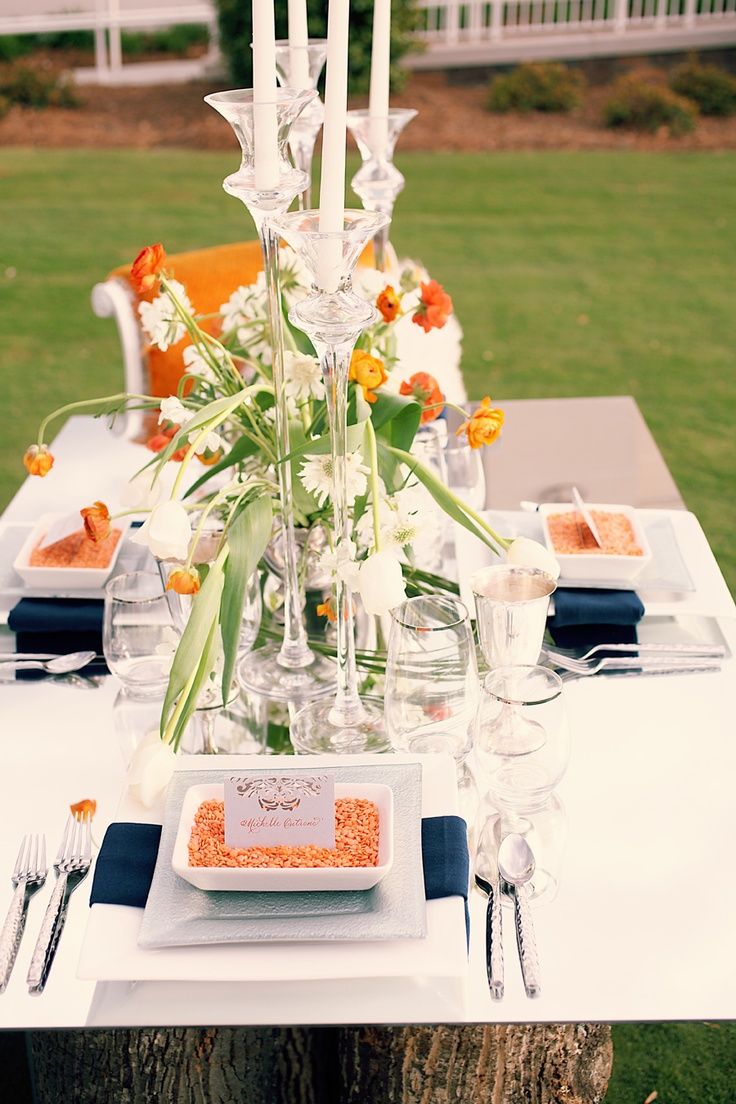 orange and navy table set up