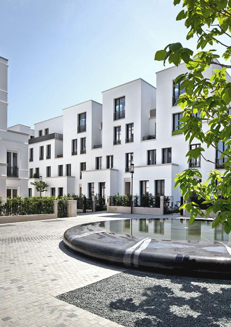 SOPHIENTERRASSEN. Kleiner Platz mit Brunnen/ Stadthausgruppe. MRLV Architekten, © Jochen Stüber, Hamburg