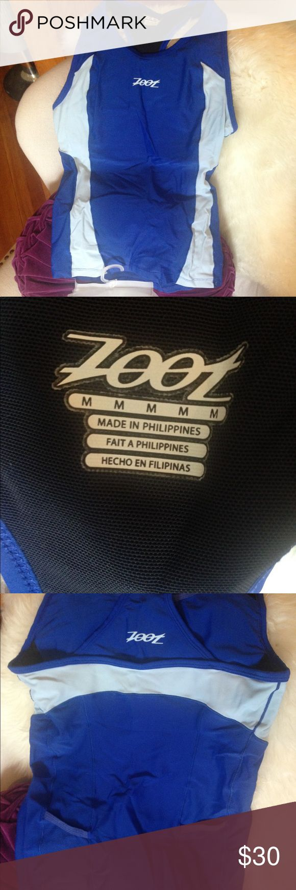 Zoot triathlon, bike, athletic top Impeccable condition. Built in sports bra, two back water/food pockets, compression, awesome racing gear. Zoot Other