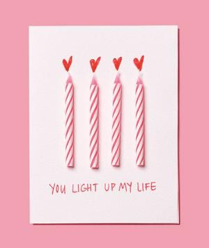 Turn a birthday party prop into a loved one's bright spot on February 14. All you'll need to make this card is a blank note card, glue, and a felt tip marker.