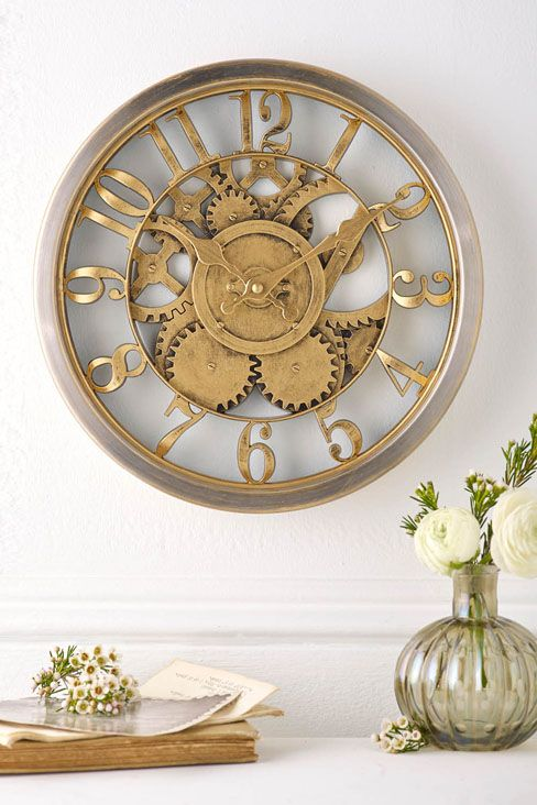 Hometime Gold Wall Clock £20.00 Stunning vintage style cog design wall clock, with metal outer rim. Complete with hanging fixture on the back. Requires 1 x AA battery (not included). Diameter 30cm