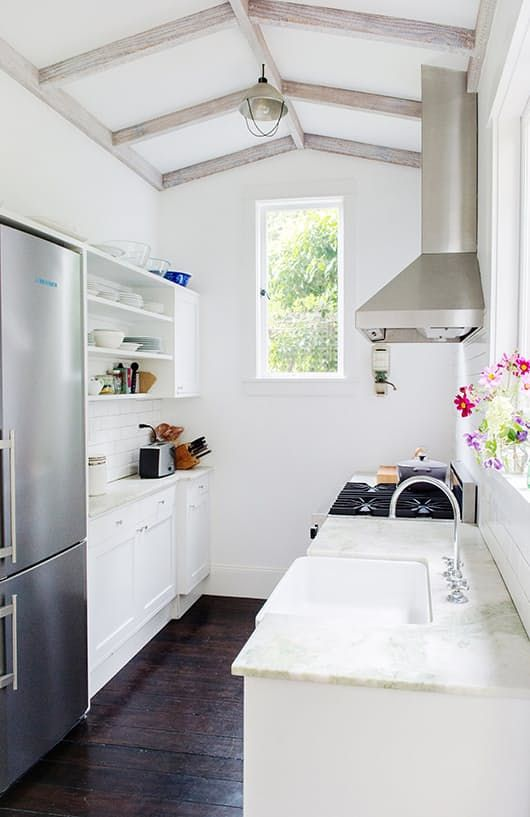 """If you live in a little apartment or a small home, chances are high that you have that dreaded real estate term: the """"galley kitchen."""" Named after the narrow kitchens on ships, these rooms may be tight, but they're also known for using what little space there is very efficiently. To prove how cozy, stylish and functional a galley kitchen can be, we've rounded up ten pin-worthy rooms full of inspiring ideas for your next remodel."""