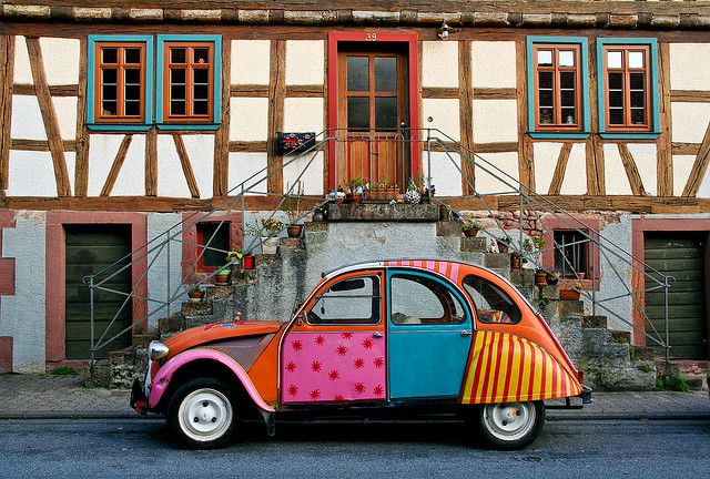 """Trippy Old Duck - Hippie Alte Ente    A 1970's themed Citroen 2CV, nicknamed """"Ente"""" or Duck, in front of a half timbered house."""