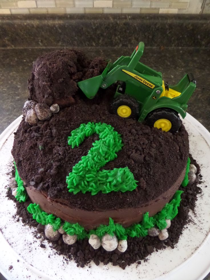 "John Deere Tractor Cake...chocolate chocolate cake, crushed up oreos ""dirt"" and oreo cream ""rocks"""