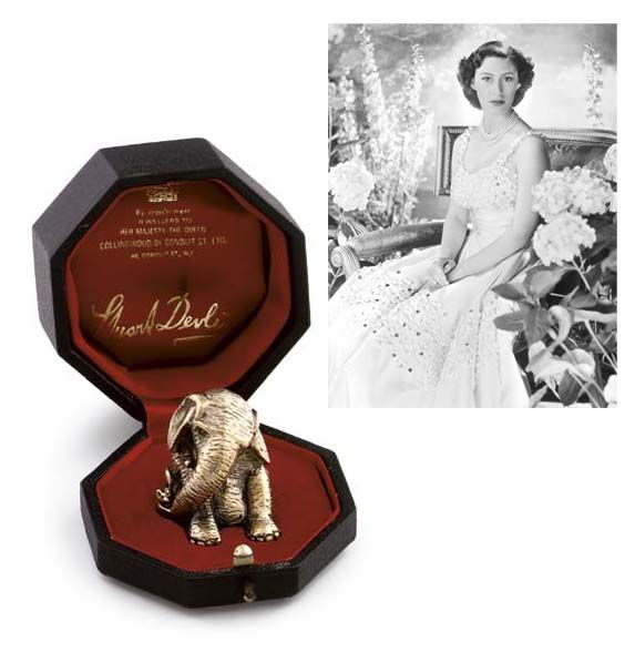 A SILVER-GILT MODEL OF AN ELEPHANT  MARK OF STUART DEVLIN, LONDON, 1971  Humorously modelled with a mouse, marked underneath, contained in a fitted case labelled 'By Appointment Jewellers to Her Majesty the Queen Collingwood of Conduit St. Ltd. 48 Conduit St. W.1' and with facsimilie signature 'Stuart Devlin', FROM THE COLLECTION OF H.R.H. THE PRINCESS MARGARET, COUNTESS OF SNOWDON.