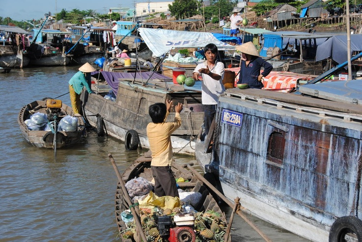 Photo of the Day – Floating Fruit Market – #Mekong_Delta, #Vietnam  On our trip to the Mekong Delta, Brad and I took a boat tour of the Mekong Delta which took us directly through their Floating Fruit Market. The concept is simple. Instead of stalls setup for vendors to sell their goods, boats congregate on the river offering up all types of fruits and vegetables.