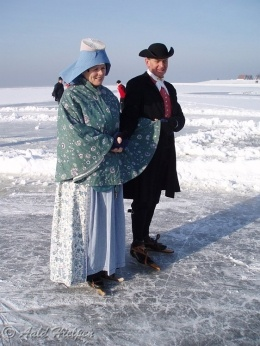 Europe | Portrait of a couple wearing traditional clothes, Hindeloopen, Friesland, The Netherlands