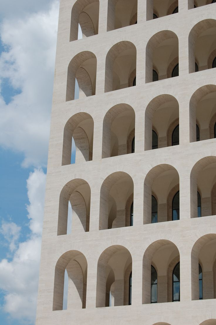 *Palazzo della Civiltà Italiana, EUR, Roma. When Mussolini promised a new world order for Italy, he set out to give Rome a Fascist façade. More than 50 years after his fall from power, Italians can't agree on what to do with the monumental buildings he left behind / Mussolini Monumental Buildings