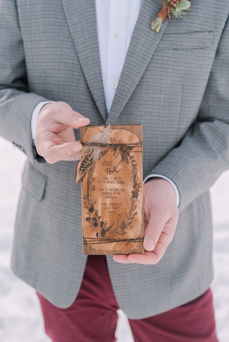 Custom vow books by Naturally Chic |Boho-Chic-winter-wedding | Design by Naturally Chic | www.naturallychic.ca  | Photo by Darren Roberts Photography | Flowers by Willow Flower Co. | Hair - Mountain Beauties | cake - Whippt Desserts | Makeup - Canmore + Banff Makeup Artistry #bohowedding #bohemianwedding