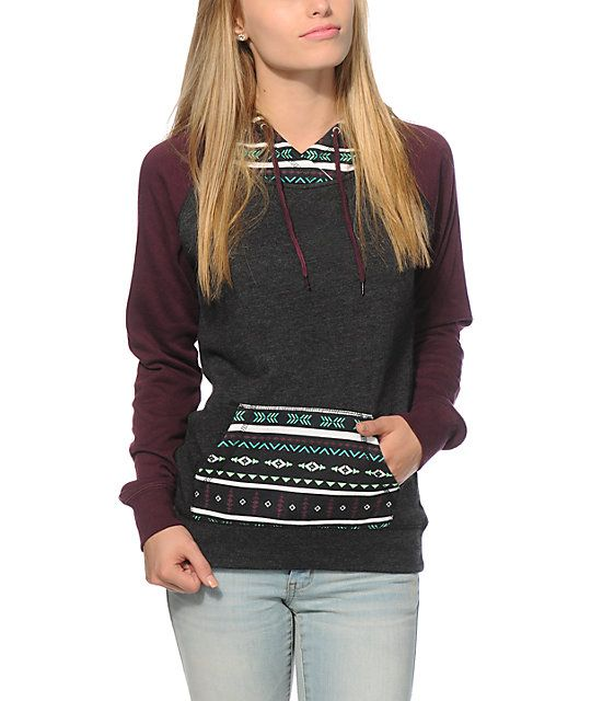Mix up your look with the long and slim fit fleece lined body accented with burgundy long raglan sleeves and a tribal print hood and pocket.