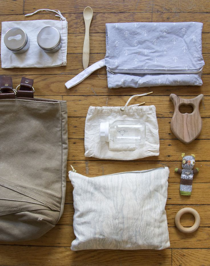 in case you're looking for encouragement in the crusade against schlepping the entire nursery on your shoulder, here's a guide to a simplified diaper bag.