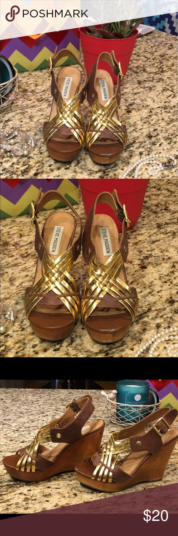 """Steve Madden wedge heels,  7M, leather uppers Steve Madden wedge shoes, size 7M, leather upper.  Brown with gold straps. Small flaw on left shoe front.  Price reflects flaw, still lots of wear on a great shoe.  4 1/2"""" heel height. Steve Madden Shoes Wedges"""
