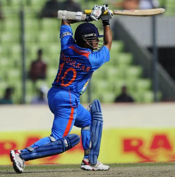 Sachin Tendulkar drives during his 100th century, Bangladesh v India, Asia Cup, Mirpur, March 16, 2012©AFP
