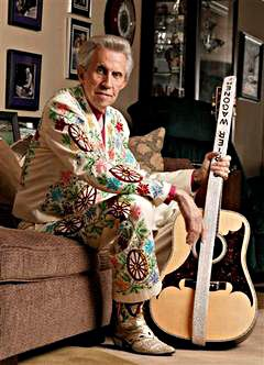 Beautiful suit--Porter Wagoner... I was lucky enough to see him live at the Grand Ol Opry. :)