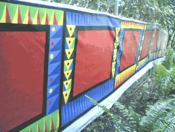 painted canvas fence by Hennie Boshoff and Vulindlela