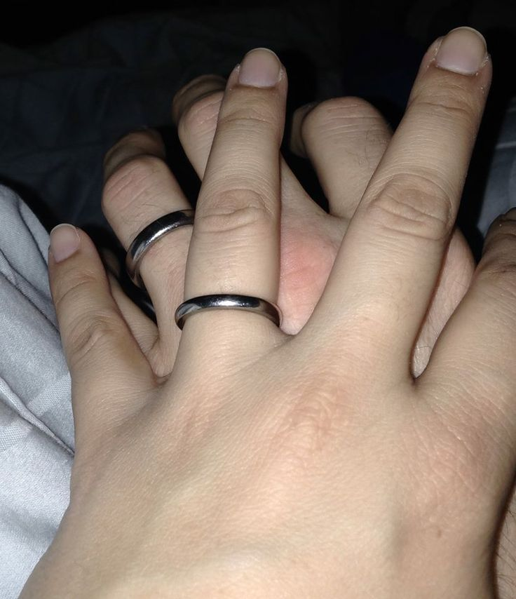 """""""My husband and I both with our rings on, on our anniversary. This is ring #3 for my husband. #1 lost while surfing and #2 lost while golfing or at work - all 3 from you, it's the only ring he's ever worn."""" -Vanessa"""